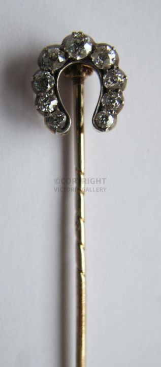 Antique Diamond Horseshoe Stick Pin. Approx 0.6cts.
