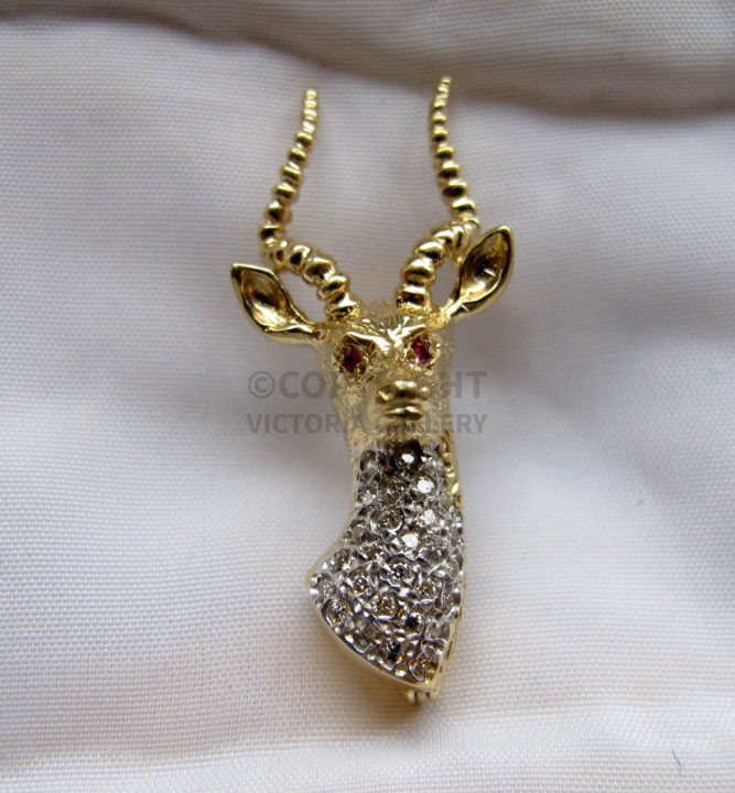 Diamond & 9ct Gold Stag Brooch. Ruby eyes. L.3.9cm. W. 7.6g.